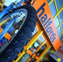 Halfords  profits hit by weaker pound